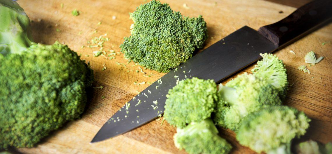 Closeup of cut fresh broccoli on cutboard