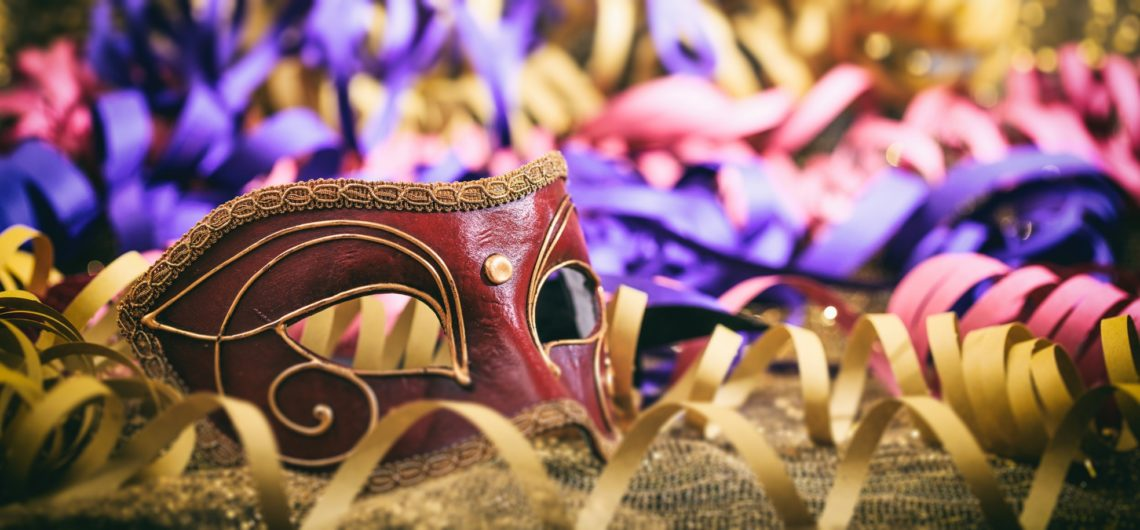 Paniccia carnevale Carnival mask on colorful blur background